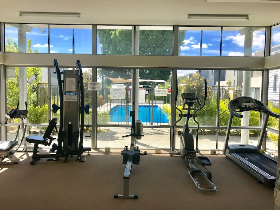 Gym overlooking the pool