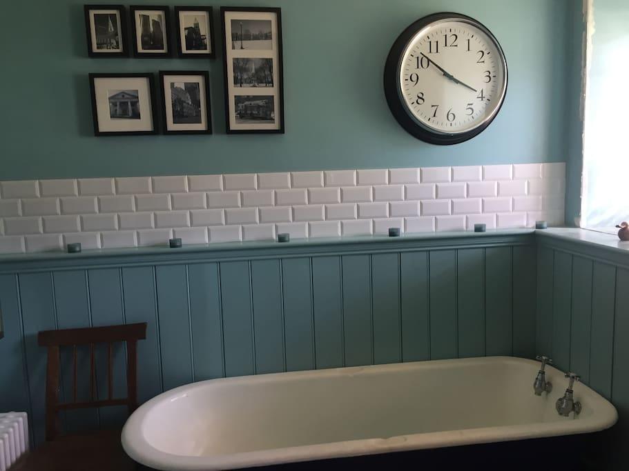 Original cast iron roll top bath