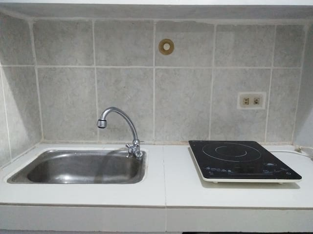 Granite material sink. With Induction stove and electric pot.