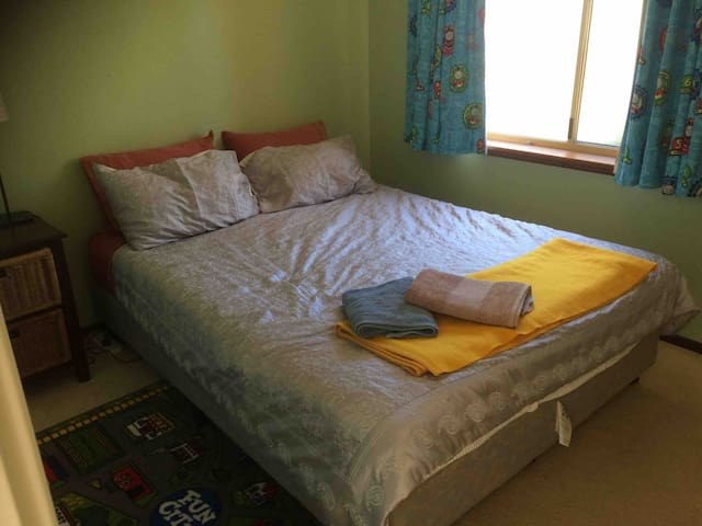 Second bedroom with queen sized bed, bedding and towels provided.