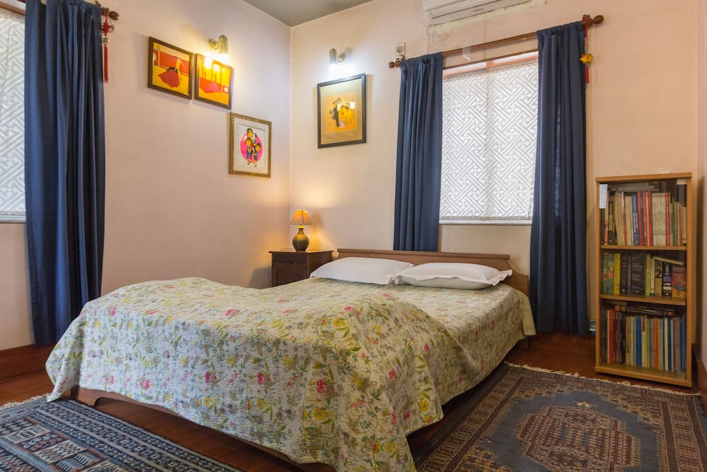 Another view of the master en-suite bedroom - wooden floors, Kashmiri handwoven carpets, 300 TC bed linen, memory foam pillows, original contemporary Indian and foreign art and hand embroidered kantha eiderdowns!