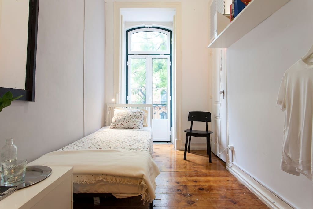 Room with a balcony, nice wooden floors