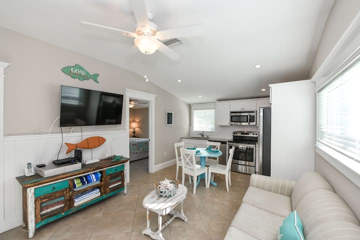 Adorable 3 bedroom condo, just across the street from the beach! Private pool!
