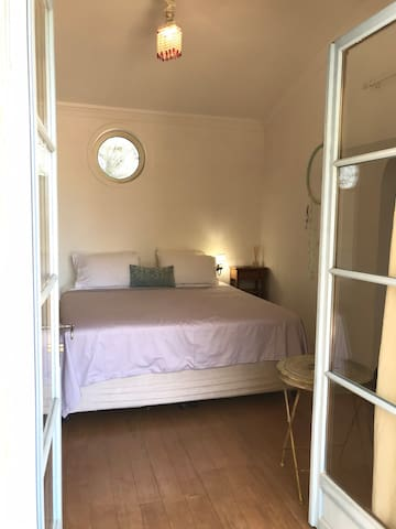 Light and fresh bedroom with king sized bed and ensuite