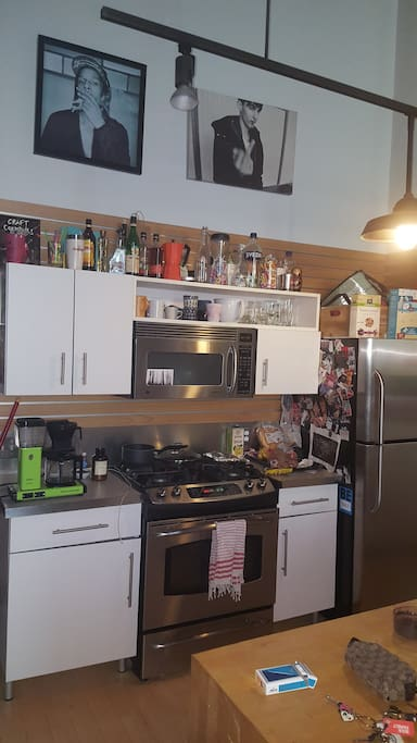 Kitchen with convection oven, dishwasher, coffee maker