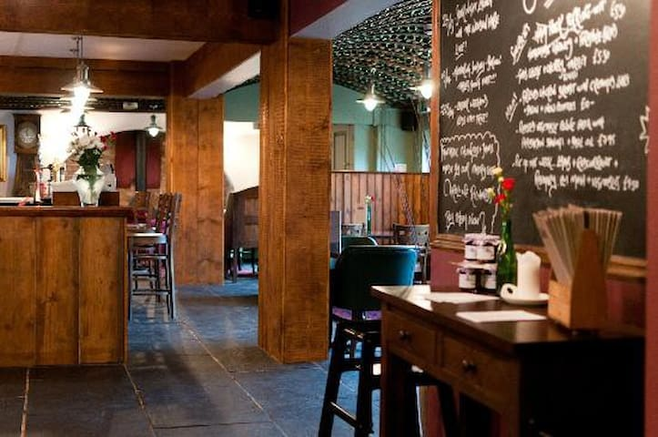 The Oak Pub (400 yards). Real ale, good food, blazing fire. Open all day.