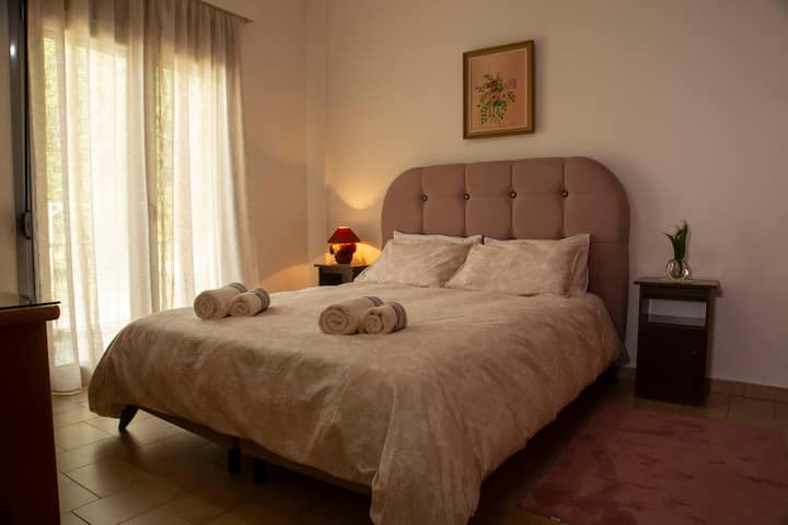 Bedroom with double bed in a vintage style house