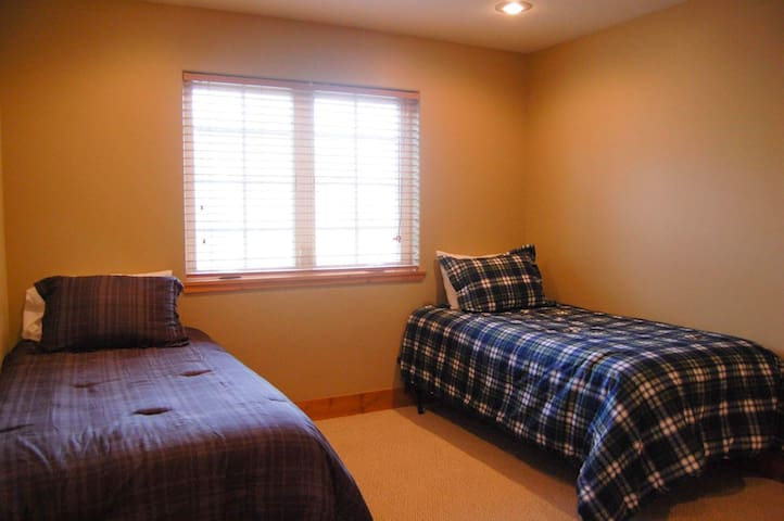 Guest bedroom with large closet , plenty of storage.