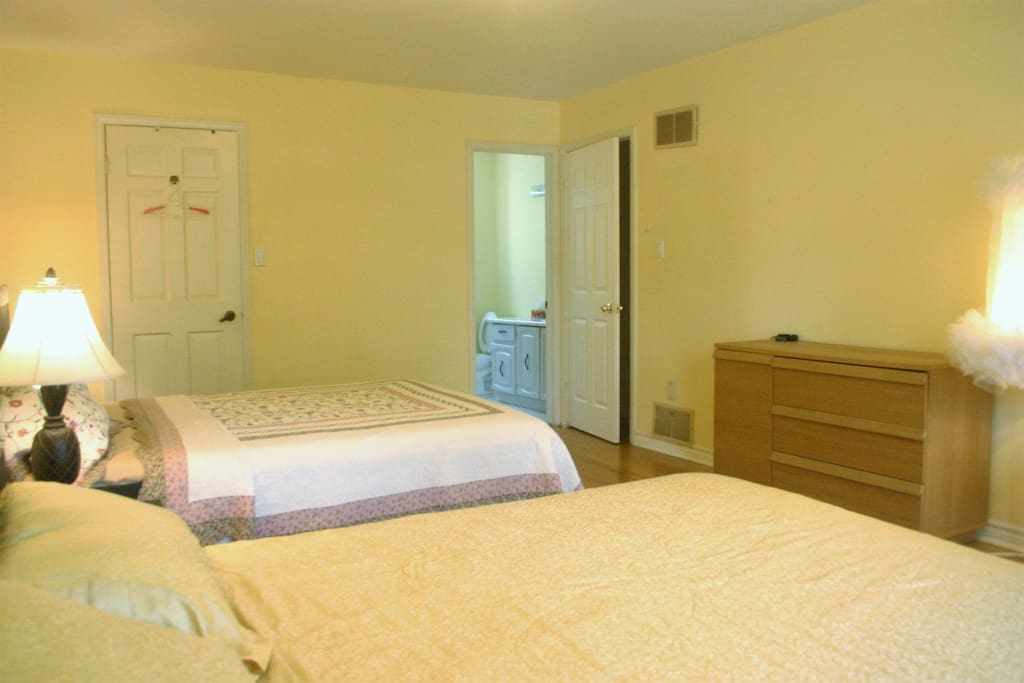 Master bedroom room with double queen beds and ensuite washroom.