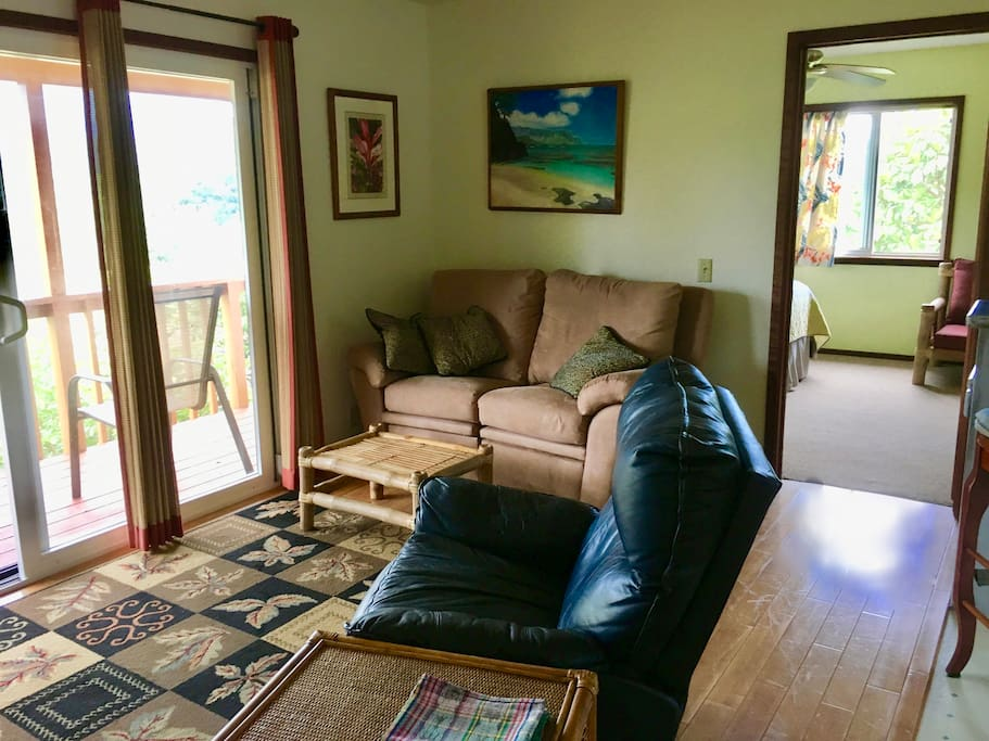Living room with recliner, love seat, TV with cable and hi speed wifi.
