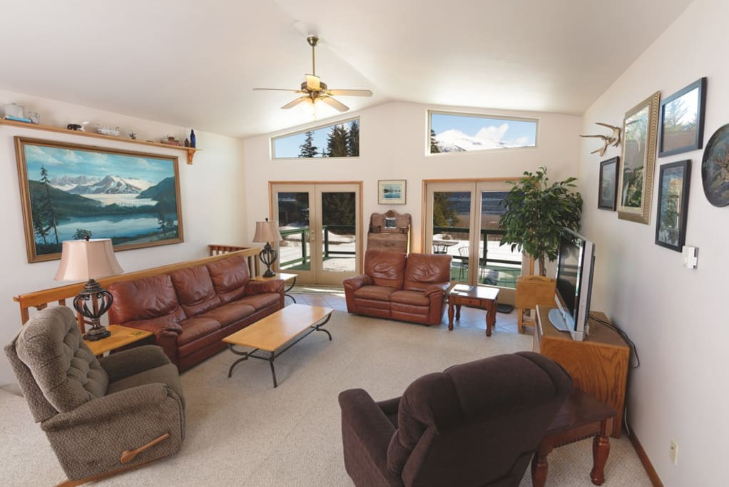 Living room with doors to deck