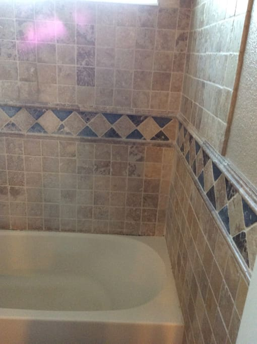 Travertine and granite full bathroom