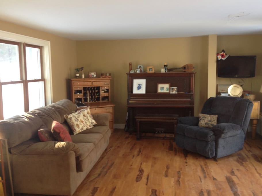 Spacious living room area with sofa and recliner