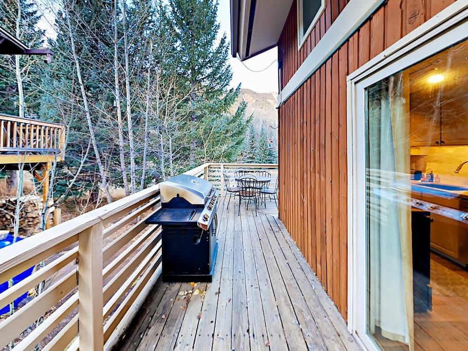 The wraparound deck is a relaxing spot for a barbecue and family time.