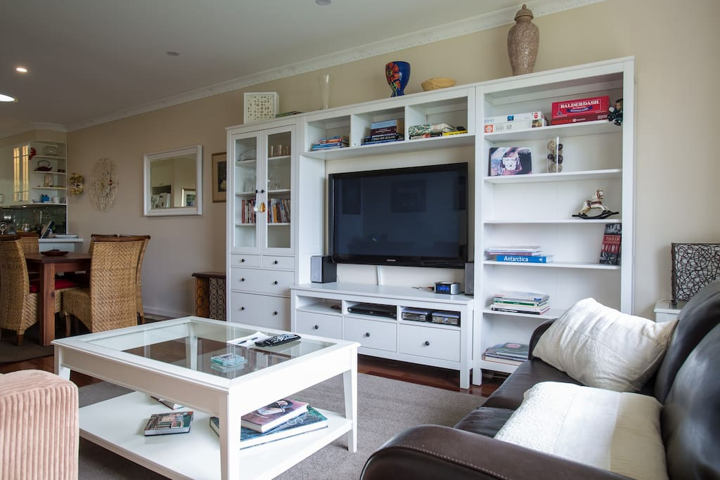 Entertainment unit with large screen TV and music system.