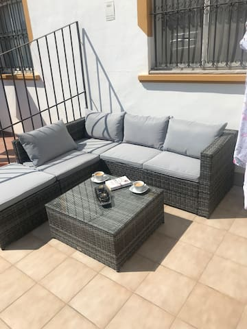 One of the outside seating areas of this ground floor apartment, stunning new waterproof luxury couch set.  2.5m x 2.5m.