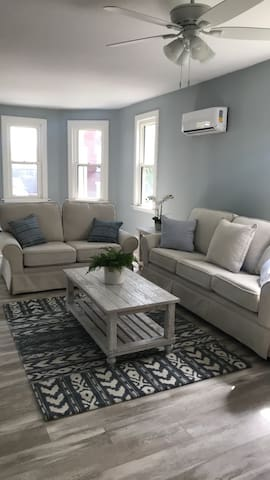 Bright and cozy living room with plenty of space to entertain!