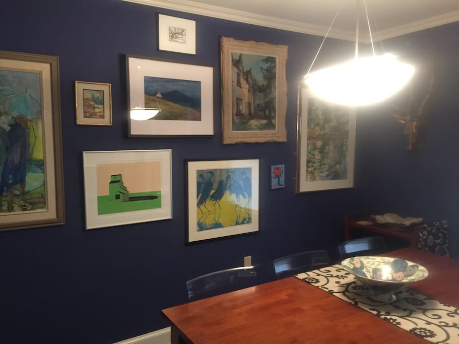 Enjoy works of art in the dining room and throughout my home