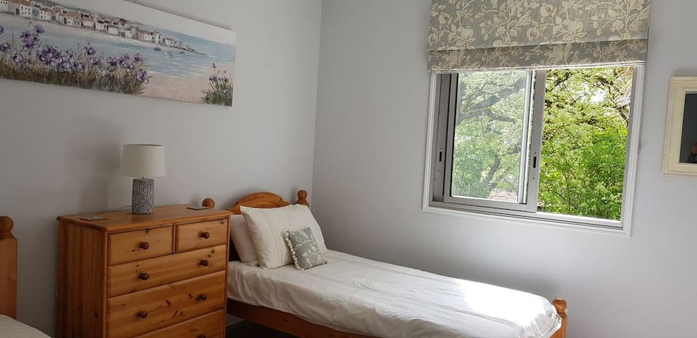 Bedroom 2 with Twin single beds with view of front garden