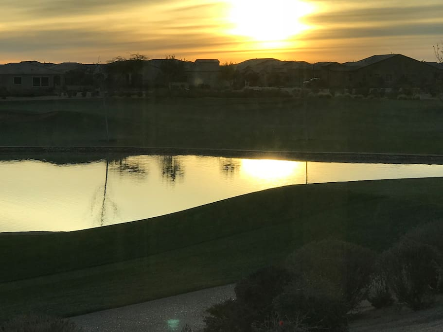 Sunrise over pond on golf course.