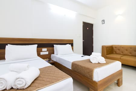 Twin Room - Room with 2 single beds which also has a kitchenette, 2 seater sofa, fridge and an en-suite bathroom
