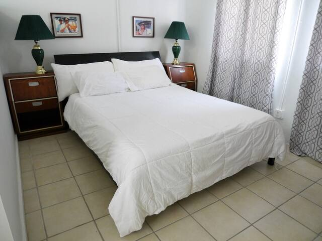 Exceptionally comfortable Queen Bed with dual night stands and reading lamps.