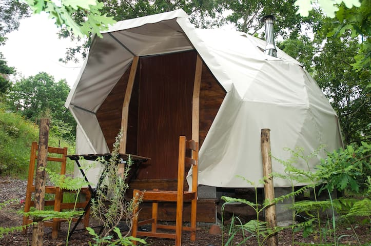 Geodesic domes in a stunning riverside setting,