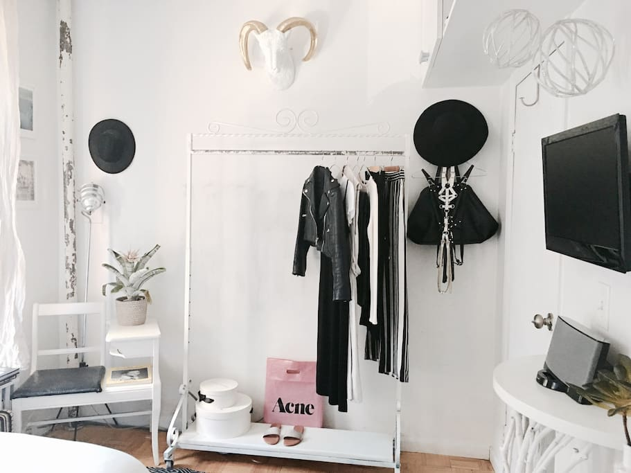 BEDROOM: FULL USE OF CLOTHING RACK + HANGERS + WALL HOOKs. Great for those who overpack. :) WALL MOUNTED TV EXTENDS OUT FROM WALL AND CAN BE VIEWED FROM VARIOUS ANGLES. (Any of my personal items are only shown for photo purposes and will be cleared out for guest(s)