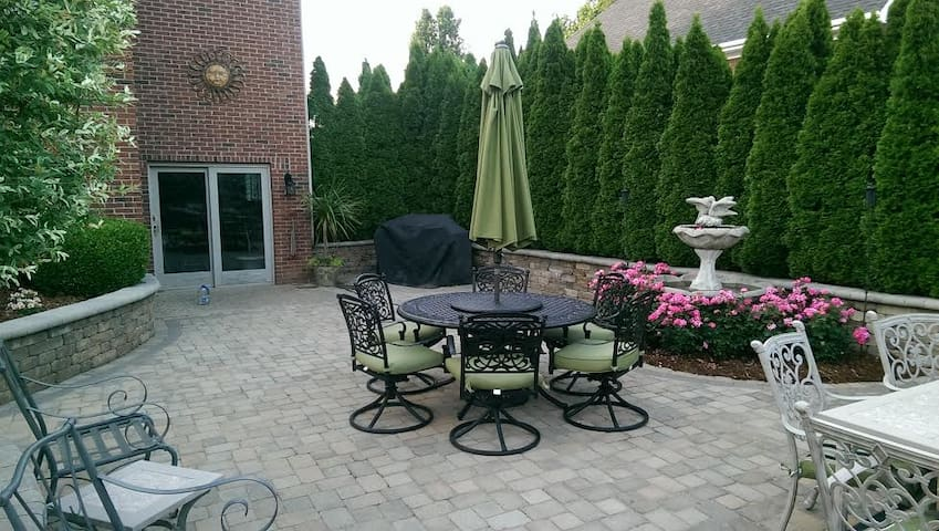 Back Patio with water fountain and plenty of seating