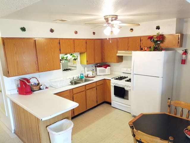 Kitchen with full size appliances.  Has all the basics for cooking meals.