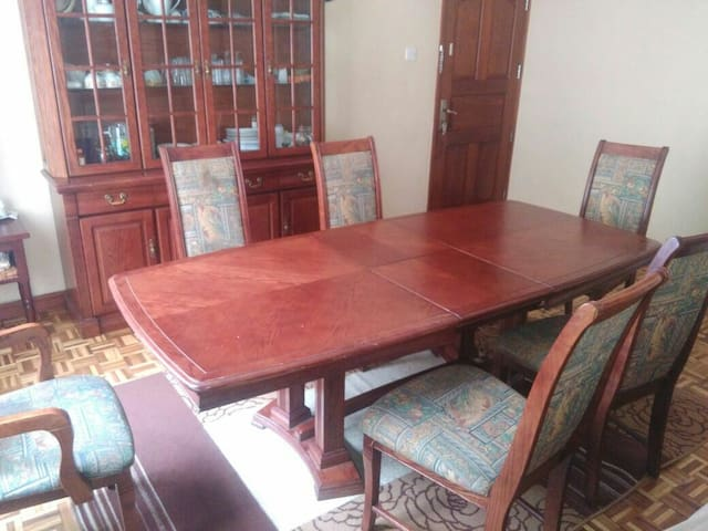 Spacious dining space with a utensils cabinet and a pure water dispenser.
