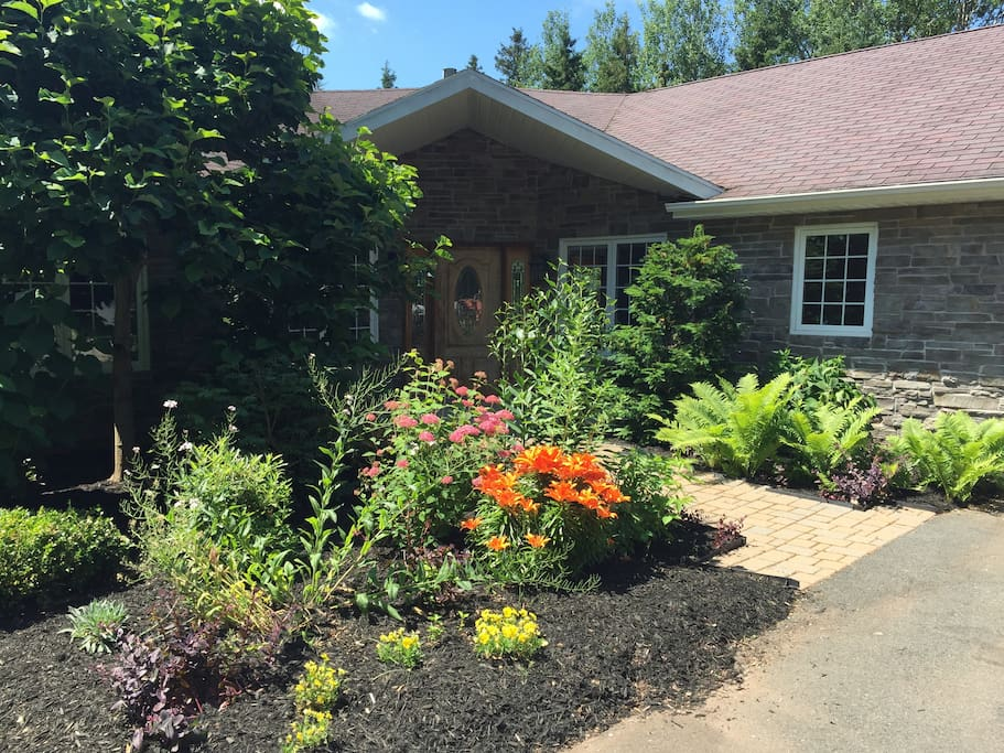 Front entrance of cottage with gardens