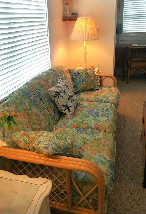 Comfy couch converts to a comfortable sofa bed.