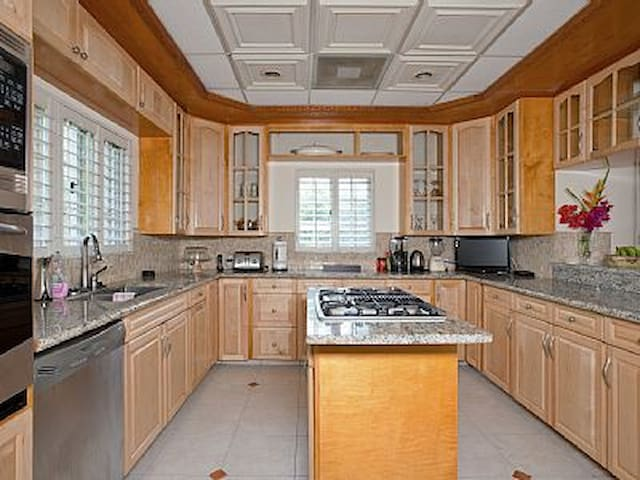 Beautiful maple kitchen with stainless steel appliances.