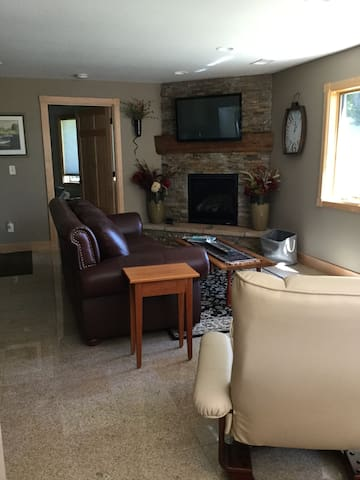 Family room with gas fireplace and flatscreen TV