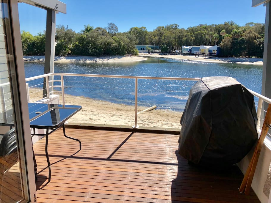 The deck overlooking the lagoon with BBQ and table and chairs