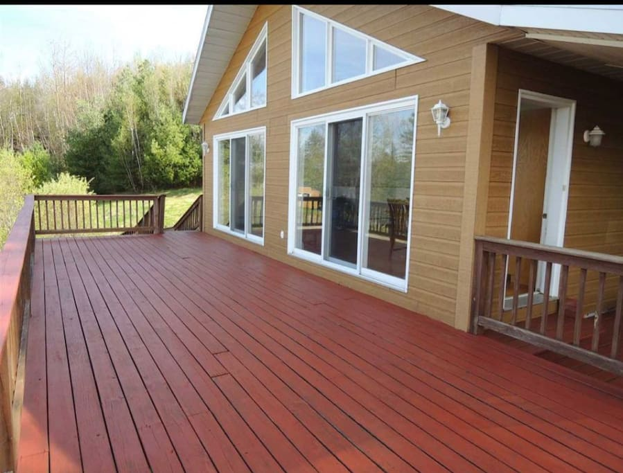 Wrap around Deck with chairs.