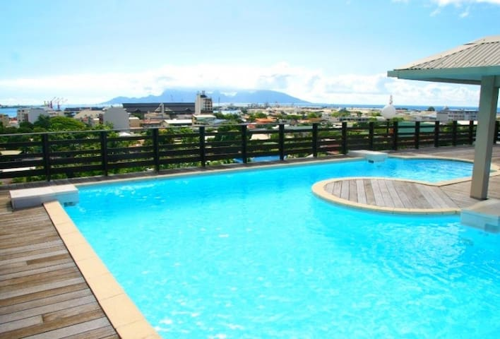 joli studio centre ville Papeete vue et piscine