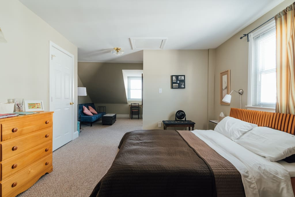L shaped suite with sitting and reading area and futon. Additional nook for air mattress not shown