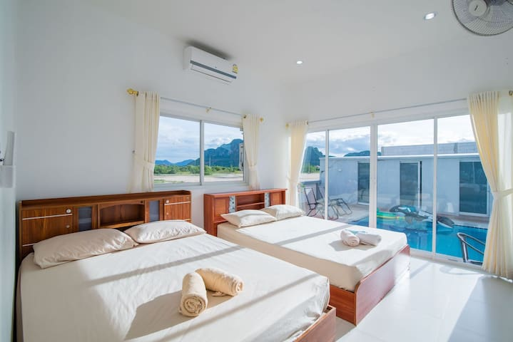 Superior room with pool and garden view