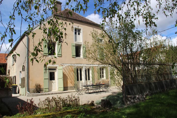Beautiful country house with enclosed garden in green surroundings in Burgundy.