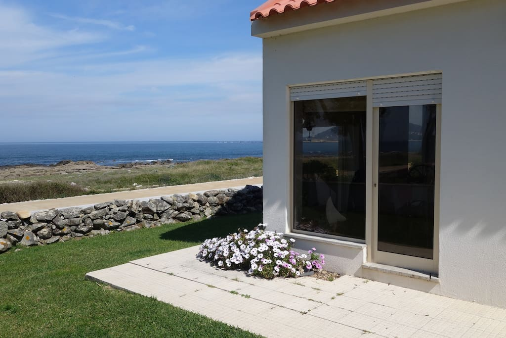 Window's house on the rocks of Moledo beach