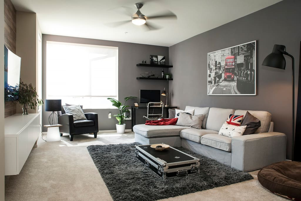 """Plenty of seating in the living room, with a large 55"""" LED TV and the latest Apple TV chock full of entertaining apps — plus gigabit Wi-Fi access!"""