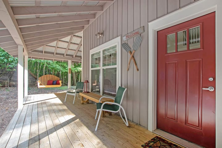 Covered porch with swing to relax in the breeze