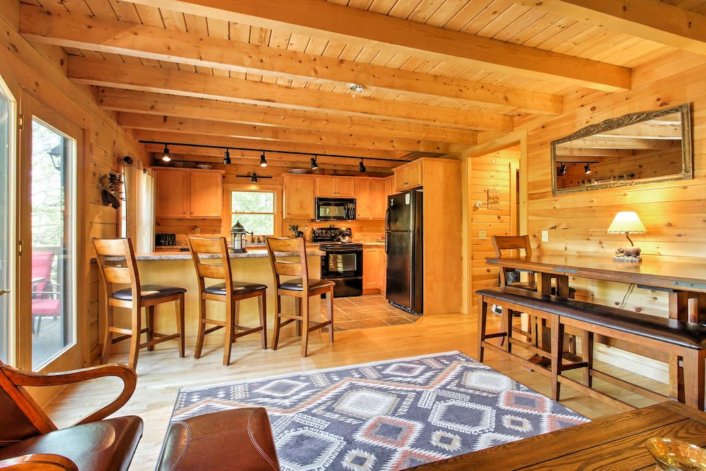 Floor-to-ceiling wood paneling creates a warm and welcoming atmosphere throughout the home.