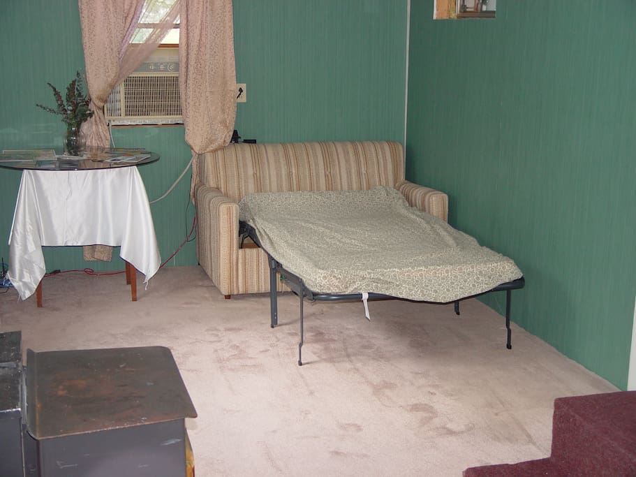 """The small couch opens up to small bed. Mattress is 66"""" X 36""""."""