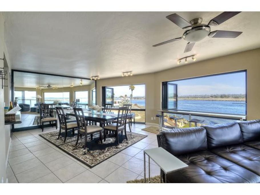 Dining area with panoramic views of the Jetty, Mission Bay, and Pacific Ocean
