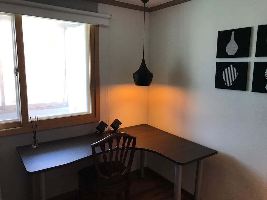 Your working desk with speakers and lamp.