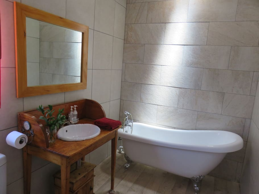 Bathroom with shower, basin and Victorian bath