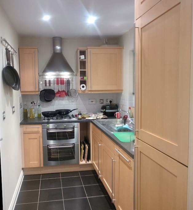 Full kitchen with gas hob and electric oven/grill and extractor fan